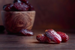 Juicy dates on a old wooden table . Copy space , selective focus .