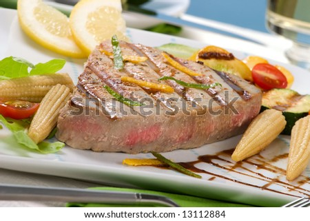 Juicy delicious Citrus-peppercorn-spiked grilled tuna steak with grilled vegetables