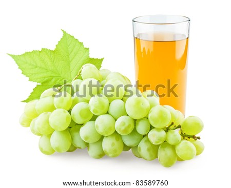 Juicy grape with leaf and full glass of juice on white background