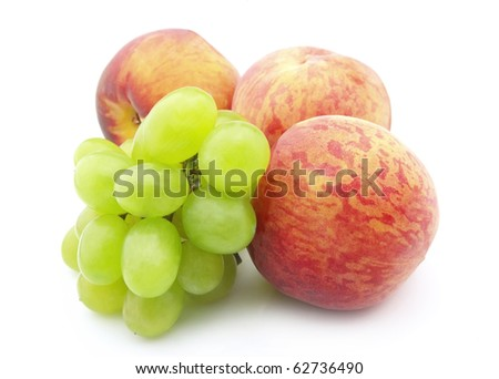 Juicy grapes and  peaches on a white background