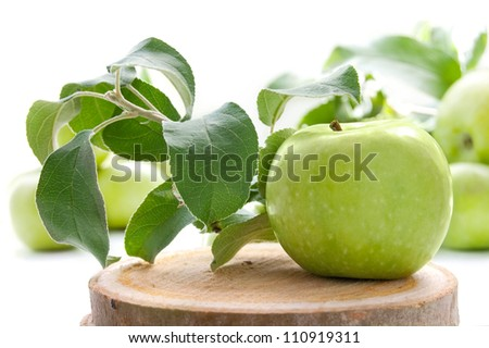 Juicy green apples in basket on the white background