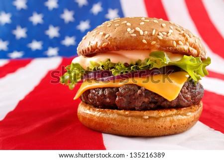 Juicy grilled hamburger on USA flag background