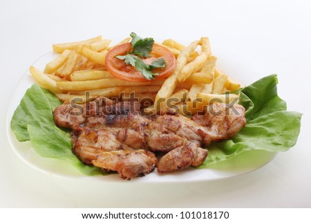 Juicy grilled pork chop (neck cut) with french fries