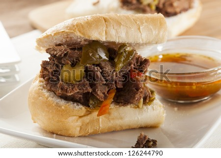 Juicy Homemade Italian Beef Sandwich with hot peppers