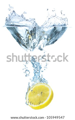 Juicy lemon and water splash. Tasty and healthy food