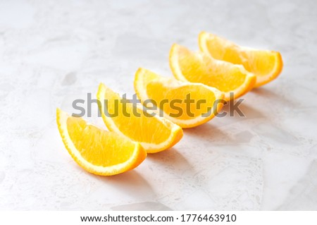 Juicy orange slices are on the table