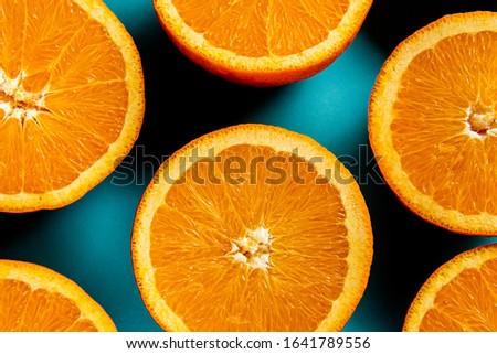 Juicy oranges on a blue background. The orange pulp. Orange background