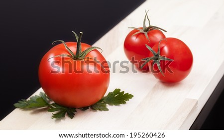 Juicy organic Cherry Tomatoes - Close-up. Cherry tomatoes are perfect for salads, soups, sandwiches, or just popped into your mouth for a tasty, healthy snack.