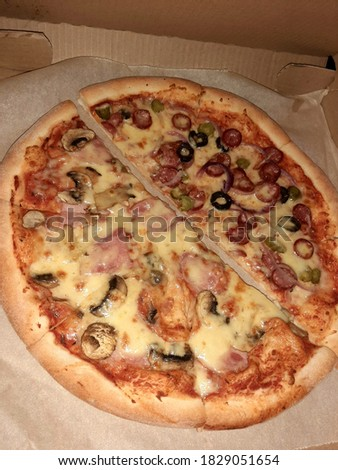 Juicy pizza, double taste: assorted and ham with mushrooms. Сток-фото ©