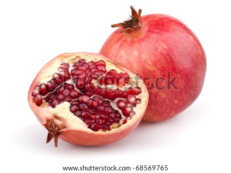Juicy pomegranate and half. Isolated on a white background