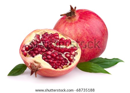 Juicy pomegranate and its half with leaves. Isolated on a white background