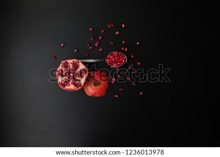 Juicy red pomegranate on a black background