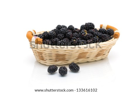 juicy ripe blackberries in a basket on a white background. horizontal photo.