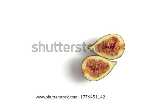 Juicy ripe figs on a white background.