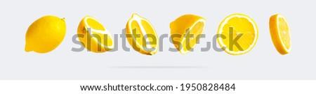 Juicy ripe flying yellow lemons on light gray background. Creative food concept. Tropical organic fruit, citrus, vitamin C. Lemon slices. Summer minimalistic bright fruit background. Pattern