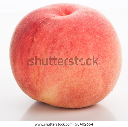 Juicy ripe peach on a white