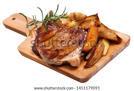 Juicy roasted entrecote served with baked potatoes and rosemary. Isolated over white background