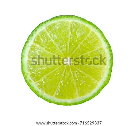 Juicy slice of lime isolated on white #716529337