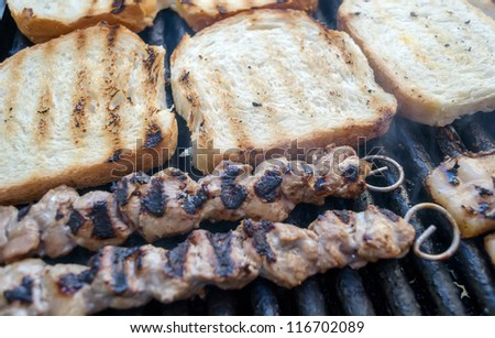 Juicy slices of meat, bacon, toast and peppers - grilled