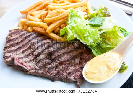juicy steak beef meat with salad and french fries