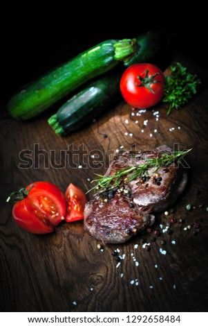 Juicy steak medium rare beef with spices and grilled vegetables. Top view #1292658484