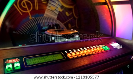 Jukebox automatically rearranging discs for playing music with coin is inserted #1218105577