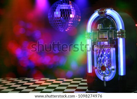 Jukebox in Bar with Disco Ball and Bokeh #1098274976