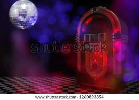 Jukebox in Bar with Disco Ball and Bokeh #1260893854