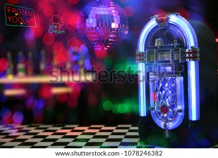 Jukebox in Ice Cream Parlor. Miniature set with neon composites.  #1078246382