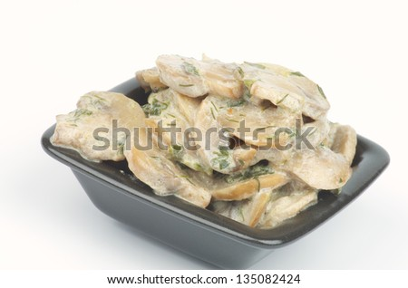 Julienne with Mushrooms, Sour Cream and Greens in Square Black Bowl isolated on white background