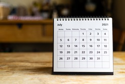 July 2021 calendar - month page showing date on wooden table