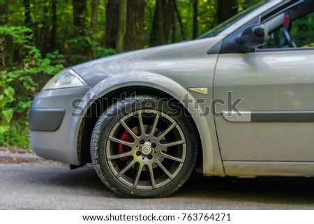 July 10 2017 Pitesti, Romania, East Europe. Sport rim on a Renault Megane with red brakes. Summer tire.  #763764271