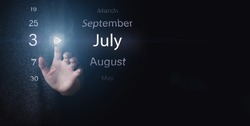 July 3rd. Day 3 of month, Calendar date. Hand click luminous icon PLAY and DATE on dark blue background. Summer month, day of the year concept