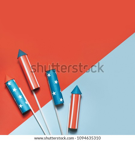 July 4, rockets for fireworks on a blue red background with space for text. in the style of minimalism #1094635310