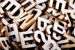 Jumbled wooden letters close up