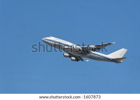 Jumbo jet ascending after takeoff