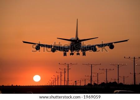 Jumbo jet coming in for a sunset landing