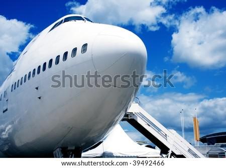 Jumbo jet in airport - stock photo