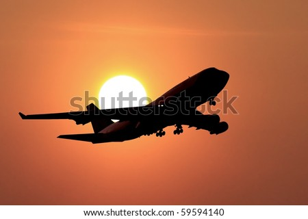jumbo jet landing in a sunset