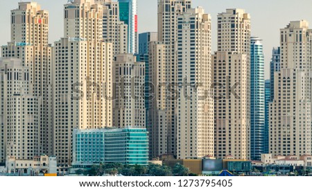 Jumeirah Beach Residence skyline at sunset time as seen from the palm jumeirah with sea . Dubai, United Arab Emirates