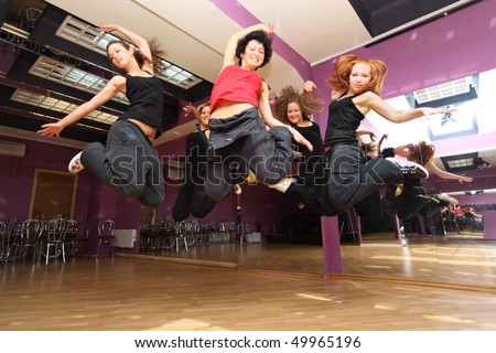 jump dancing collective in show room before statement - stock photo
