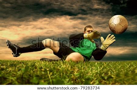 Jump of football goalman on the outdoor field - stock photo