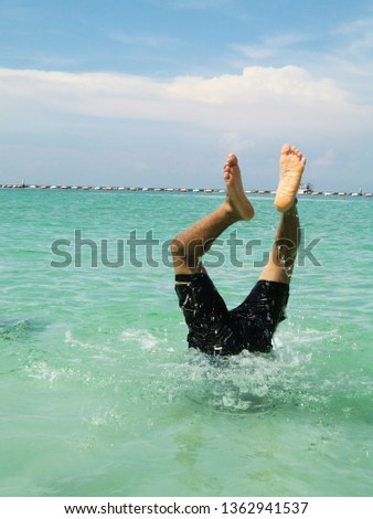 Jump somersault into the sea #1362941537