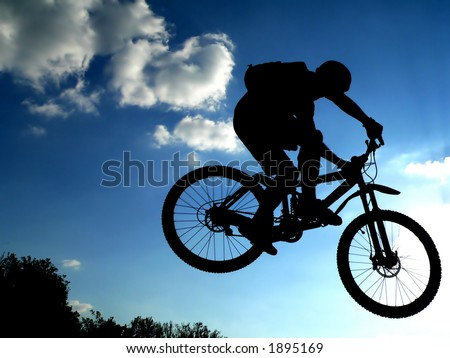 jump with a mountain bike silhouette