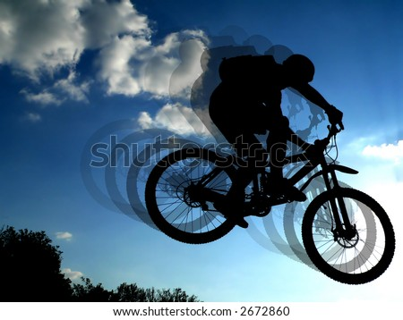 jump with a mountain bike - silhouette