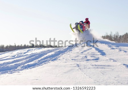 jump with a snowmobile #1326592223
