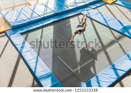 jumping area. jumping surface. super fun trampolines. full length photo. copy space. tips fot jumpers. spiderman over the trampoline