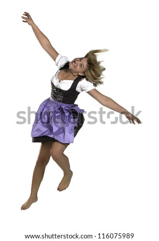 jumping blond woman wearing a traditional dress named dirndl