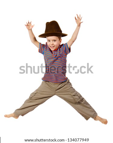 Jumping boy in big hat, isolated on white