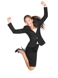 Jumping business woman. Celebrating successful businesswoman in suit jumping joyful isolated on white background in full length. Beautiful mixed race Asian Caucasian female model.